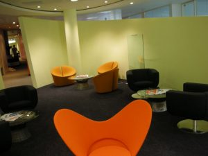 colourful seating area in an office with several tables and chairs