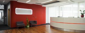 orange and white themed office reception area with parquet flooring